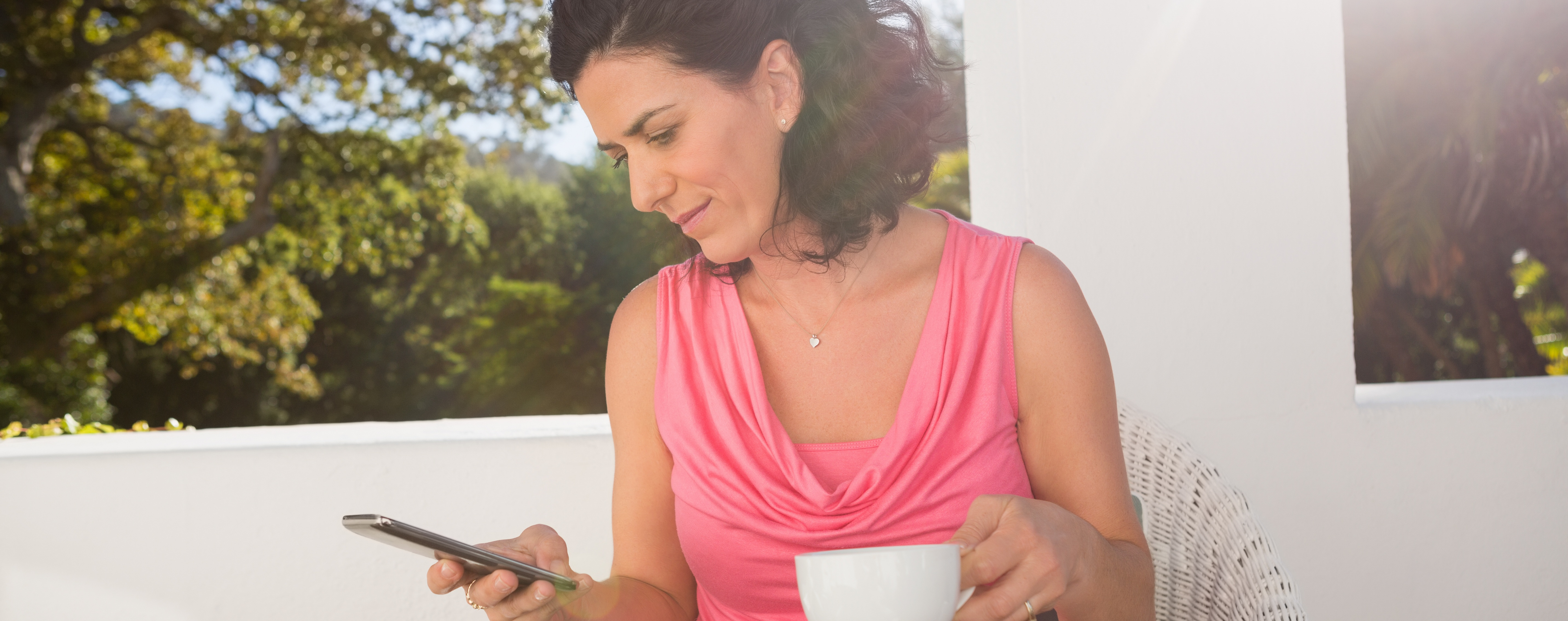 woman on balcony coffee phone cropped-1